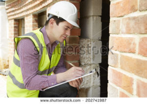 stock-photo-architect-checking-insulation-during-house-construction-202741987