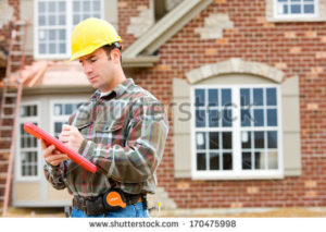 stock-photo-construction-home-inspector-reviews-documents-170475998