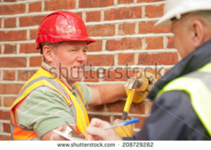 stock-photo-construction-workers-208729282